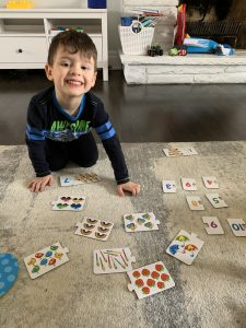 child playing card games